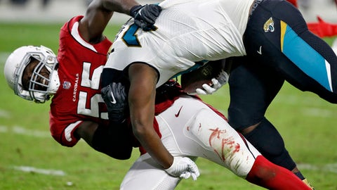 FILE - In this Nov. 26, 2017, file photo, Arizona Cardinals outside linebacker Chandler Jones (55) tackles Jacksonville Jaguars running back Leonard Fournette during the second half of an NFL football game in Glendale, Ariz. Jones is having the kind of monster season the Arizona Cardinals envisioned when they rewarded him with such a big contract.  (AP Photo/Ross D. Franklin)