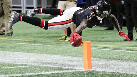 FILE - In this Nov. 26, 2017, file photo, In this Atlanta Falcons wide receiver Julio Jones reaches over the goal line to score a touchdown during the second quarter of an NFL football game against the Tampa Bay Buccaneers in Atlanta. Jones had a season-best 12 receptions for 253 yards and two TDs against the Bucs three weeks ago, his NFL-record third game with 250-plus yards receiving. (Curtis Compton/Atlanta Journal-Constitution via AP, File)