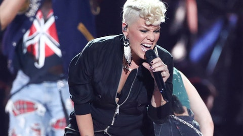 FILE - In this Sept. 22, 2017, file photo, Pink performs at the 2017 iHeartRadio Music Festival Day 1 held at T-Mobile Arena in Las Vegas. Pink is joining the list of stars performing in Minneapolis during Super Bowl week. The singer will perform Friday, Feb. 2, 2018, at Nomadic Live! in the refurbished Minneapolis Armory building.(Photo by John Salangsang/Invision/AP, File)