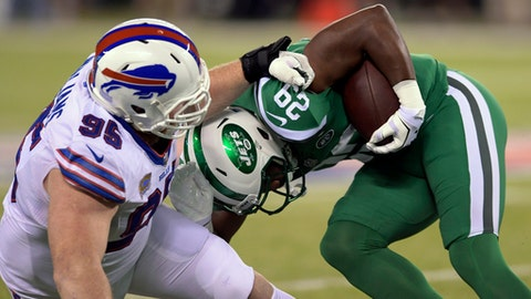 FILE - In this Nov. 2, 2017, file photo, Buffalo Bills defensive tackle Kyle Williams (95) brings down New York Jets running back Bilal Powell (29) during the first half of an NFL football game in East Rutherford, N.J. Williams has enough to worry about in preparing to face the Miami Dolphins than consider whether Buffalo's home finale on Sunday, Dec. 17, 2017, might be his last game at New Era Field. (AP Photo/Bill Kostroun, File)