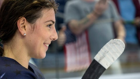 FILE - In this Sunday, Nov. 12, 2017 file photo, United States' Hilary Knight smiles deeply after winning the during the Four Nations Cup championship hockey game against Canada in Tampa, Fla. The U.S. women's national team will play two exhibitions against some familiar faces from the National Women's Hockey League next month in a final tune-up for the Olympics, Thursday, Dec. 14, 2017. (AP Photo/Willie J. Allen Jr.)