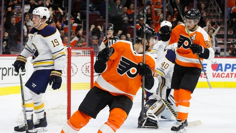 Philadelphia Flyers' Valtteri Filppula, right, of Finland, reacts to his goal on Buffalo Sabres' Robin Lehner, center right, of Sweden, during the second period of an NHL hockey game, Thursday, Dec. 14, 2017, in Philadelphia. (AP Photo/Chris Szagola)