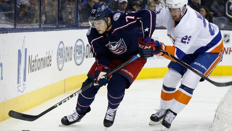 Columbus Blue Jackets' Josh Anderson, left, controls the puck behind the net as New York Islanders' Brock Nelson defends during the second period of an NHL hockey game Thursday, Dec. 14, 2017, in Columbus, Ohio. (AP Photo/Jay LaPrete)