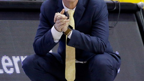 Valparaiso head coach Matt Lottich reacts as he watches his team during the first half of an NCAA college basketball game against Northwestern Thursday, Dec. 14, 2017, in Rosemont, Ill. (AP Photo/Nam Y. Huh)