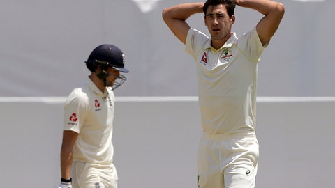 Australia's Mitchell Starc, right, puts his hands on his head after having an appeal dismissed for the wicket of England's Dawid Malan, left, during the second day of their Ashes cricket test match in Perth, Australia, Friday, Dec. 15, 2017. (AP Photo/Trevor Collens)