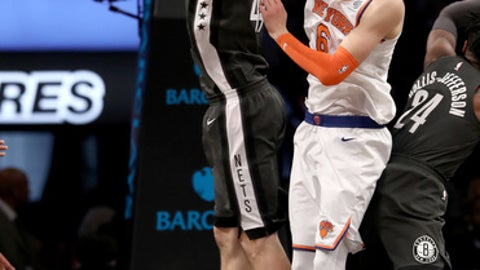 NEW YORK, NY - DECEMBER 14:  Tyler Zeller #44 of the Brooklyn Nets and Kristaps Porzingis #6 of the New York Knicks fight for the ball in the third quarter at the Barclays Center on December 14, 2017 in the Brooklyn borough of New York City.  NOTE TO USER: User expressly acknowledges and agrees that, by downloading and or using this Photograph, user is consenting to the terms and conditions of the Getty Images License Agreement.  (Photo by Elsa/Getty Images)