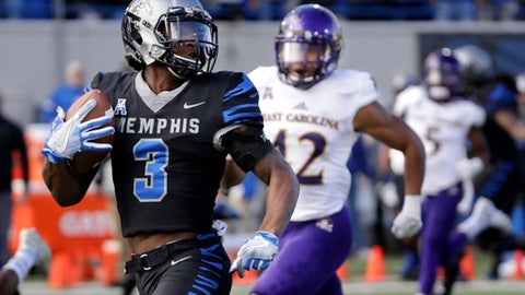 FILE -  In this Nov. 25, 2017, file photo, Memphis wide receiver Anthony Miller (3) heads for a touchdown against East Carolina in the first half of an NCAA college football game in Memphis, Tenn. FAU, Miami, Navy and Memphis are playing their bowl games on their home fields, and five other teams will play bowls in their home states. And that number could rise to six if Georgia makes the College Football Playoff championship game in Atlanta.  (AP Photo/Mark Humphrey, File)