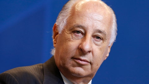 FILe - In this Oct. 22, 2015, file photo, Brazilian Football Confederation President Marco Polo del Nero listens to questions during a press conference in Rio de Janeiro, Brazil. FIFA has suspended Brazilian soccer federation president Marco Polo del Nero for 90 days while he is under an ethics investigation. Del Nero has remained in power in Brazil despite being charged by American authorities with racketeering and money laundering in 2015. FIFA says Del Nero has been provisionally banned from all soccer activities as formal ethics investigation proceedings are conducted. (AP Photo/Felipe Dana, File)
