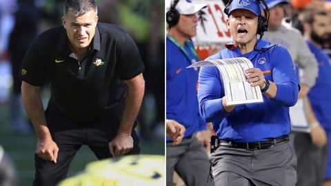 FILE - At left, in an Oct. 28, 2017, file photo, then-Oregon co-offensive coordinator Mario Cristobal watches a special team warmup drill before Oregon's game against Utah in an NCAA college football game, in Eugene, Ore. At right, in a Dec. 27, 2016, file photo, Boise State head coach Bryan Harsin yells to the official during the first half of the Cactus Bowl NCAA college football game against Baylor, in Phoenix. Oregon (7-5) will be playing for new coach Mario Cristobal when it faces No. 25 Boise State (10-3) in the Las Vegas Bowl on Saturday. (AP Photo/Matt York, File)