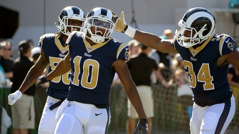 FILE - In this Oct. 15, 2017, file photo, Los Angeles Rams' Pharoh Cooper (10) celebrates his 103-yard touchdown return, on the opening kickoff, with outside linebacker Cory Littleton (58) and running back Malcolm Brown (34) during the first half of an NFL football game against the Jacksonville Jaguars, in Jacksonville, Fla. Cooper and Kansas City's Tyreek Hill split 10 of the 11 first-place votes in the AP kick returner rankings. The overall tally wasn't nearly that close, with Cooper finishing finishing 43 points ahead. (AP Photo/Phelan M. Ebenhack, File)