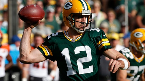 "FILE - In this Sunday, Sept. 24, 2017 file photo, Green Bay Packers' Aaron Rodgers drops back during the first half of an NFL football game against the Cincinnati Bengals in Green Bay, Wis.  Rodgers probably won't have time to catch the latest installment of the blockbuster Star Wars series when ""The Last Jedi"" opens this weekend in theaters.  Preparing for the Carolina Panthers takes precedence as he gets ready for his first action since missing seven games with a collarbone injury.(AP Photo/Mike Roemer, File)"