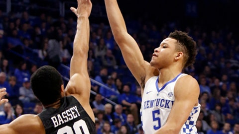 FILE - In this Dec. 2, 2017, file photo, Kentucky's Kevin Knox (5) shoots while pressured by Harvard's Justin Bassey (20) during the first half of an NCAA college basketball game, in Lexington, Ky. Though No. 8 Kentucky's youngsters have struggled at times against less-challenging opponents, they've lost only to Kansas and are starting to grasp the college game. That growth comes just in time for a long run of Power 5 foes, with Saturday's game against Virginia Tech beginning a daunting year-ending stretch that includes UCLA, rival Louisville and the SEC opener against Georgia. (AP Photo/James Crisp, File)