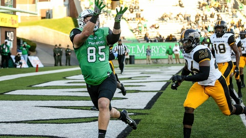 FILE - In this Nov. 25, 2017, file photo, Marshall tight end Ryan Yurachek (85) catches a touchdown pass against Southern Mississippi during an NCAA college football game in Huntington, W.Va. Colorado State and Marshall, two programs that started strong only to end finish slow this season, are meeting in the New Mexico Bowl to help kick off the college postseason. (Sholten Singer/The Herald-Dispatch via AP, File)