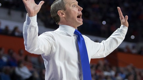 "FILE - In this Dec. 6, 2017, file photo, Florida head coach Mike White yells to his team during the first half of an NCAA college basketball game against Loyola of Chicago, in Gainesville, Fla. Florida coach Mike White would like to see a ""big jump"" in his team's defensive performance. It might not happen until February. The No. 22 Gators (6-3) rank 27th in Ken Pomeroy's college basketball defensive efficiency ratings. It's their lowest spot since 2012. It's the main concern for White heading into Saturday's game against Clemson (8-1) in Sunrise. (AP Photo/Ron Irby, File)"