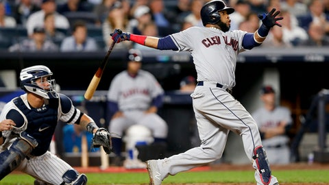 FILE - In this Oct. 9, 2017, file photo, Cleveland Indians' Carlos Santana connects for a two-run home run against the New York Yankees during the fourth inning in Game 4 of baseball's American League Division Series, in New York. Two people familiar with the situation say the Phillies and veteran first baseman Carlos Santana have agreed to a three-year, $60 million deal. The people spoke Friday, Dec. 15, 2017, on condition of anonymity because the agreement is contingent on Santana passing a physical. The 31-year-old Santana hit 23 home runs and had 79 RBIs with Cleveland last season, where he had spent all eight years of his career. (AP Photo/Kathy Willens, File)