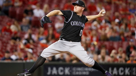 FILE - In this May 19, 2017, file photo, Colorado Rockies relief pitcher Jake McGee throws in the ninth inning of a baseball game against the Cincinnati Reds, in Cincinnati. Colorado finalized $27 million, three-year contracts with right-hander Bryan Shaw and lefty Jake McGee on Friday, Dec. 15, 2017, moves the Rockies hope will fortify their bullpen. (AP Photo/John Minchillo, File)