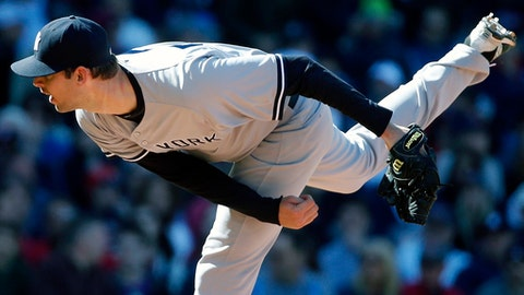 FILE - In this May 2, 2015, file photo, New York Yankees' Chris Martin pitches during the seventh inning of a baseball game against the Boston Red Sox in Boston. The Texas Rangers have finalized Martin's $4 million, two-year contract after the homegrown pitcher spent the past two seasons in Japan. (AP Photo/Michael Dwyer, File)