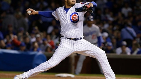 FILE - In this Thursday, Oct. 19, 2017 file photo, Chicago Cubs relief pitcher Hector Rondon throws during the third inning of Game 5 of baseball's National League Championship Series against the Los Angeles Dodgers in Chicago. Reliever Hector Rondon has agreed to an $8.5 million, two-year contract with the World Series champion Houston Astros. The 29-year-old right-hander gets $4 million next year and $4.5 million in 2019. (AP Photo/Nam Y. Huh, File)