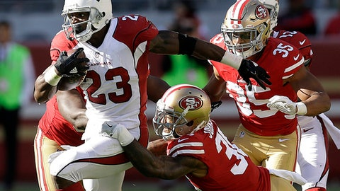 FILE- In this Sunday, Nov. 5, 2017, file photo, Arizona Cardinals running back Adrian Peterson (23) runs against the San Francisco 49ers during the first half of an NFL football game in Santa Clara, Calif. Adrian Peterson was placed on injured reserve Friday, Dec. 15, 2017 because of a neck injury, ending the running back's season after only six games with the Arizona Cardinals. (AP Photo/Ben Margot, File)