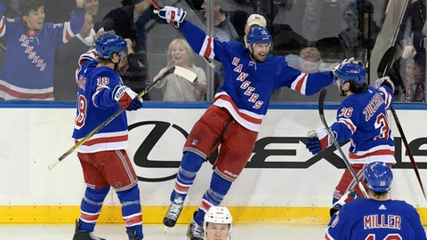 New York Rangers right wing Rick Nash (61) celebrates his goal with defenseman Marc Staal (18) and right wing Mats Zuccarello (36) during the third period of an NHL hockey game against the Los Angeles Kings Friday, Dec. 15, 2017, at Madison Square Garden in New York. (AP Photo/Bill Kostroun)