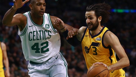 BOSTON, MA - DECEMBER 15:  Ricky Rubio #3 of the Utah Jazz drives to the basket on Al Horford #42 of the Boston Celtics during the fourth quarter of the game at TD Garden on December 15, 2017 in Boston, Massachusetts. NOTE TO USER: User expressly acknowledges and agrees that, by downloading and or using this photograph, User is consenting to the terms and conditions of the Getty Images License Agreement.  (Photo by Omar Rawlings/Getty Images)