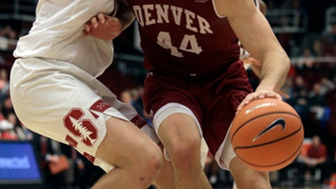 Denver's Daniel Amigo, right, drives the ball against Stanford's Michael Humphrey during the second half of an NCAA college basketball game Friday, Dec. 15, 2017, in Stanford, Calif. (AP Photo/Ben Margot)