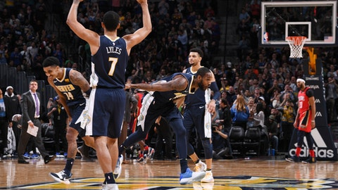 DENVER, CO - DECEMBER 15:  The Denver Nuggets celebrate on the court in overtime against the New Orleans Pelicans on December 15, 2017 at the Pepsi Center in Denver, Colorado. NOTE TO USER: User expressly acknowledges and agrees that, by downloading and/or using this Photograph, user is consenting to the terms and conditions of the Getty Images License Agreement. Mandatory Copyright Notice: Copyright 2017 NBAE (Photo by Garrett Ellwood/NBAE via Getty Images)