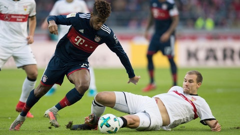 Munich's  Kingsley Comanleft, challenges with Stuttgart's Holger Badstuber during the German Bundesliga soccer match between VfB Stuttgart and Bayern Munich, in Stuttgart, Germany, Saturday, Dec. 16, 2017. (Deniz Calagan/dpa via AP)