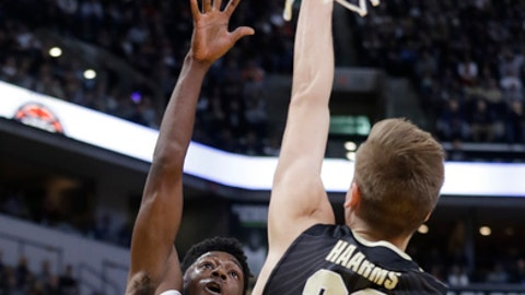 Butler's Kamar Baldwin (3) shoots over Purdue's Matt Haarms (32) during the first half of an NCAA college basketball game, Saturday, Dec. 16, 2017, in Indianapolis. (AP Photo/Darron Cummings)