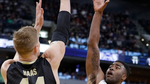 Butler's Kelan Martin shoots over Purdue's Isaac Haas (44) during the first half of an NCAA college basketball game, Saturday, Dec. 16, 2017, in Indianapolis. (AP Photo/Darron Cummings)
