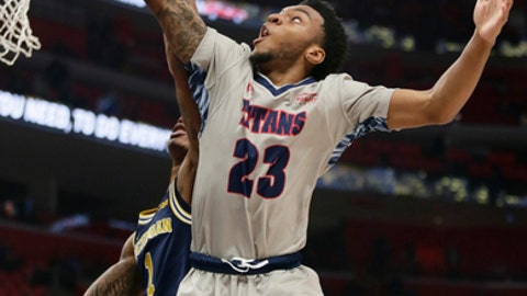 Detroit's Josh McFolley (23) tries to grab a rebound against Michigan's Charles Matthews (1) during the first half of an NCAA college basketball game Saturday, Dec. 16, 2017, in Detroit. (AP Photo/Duane Burleson)