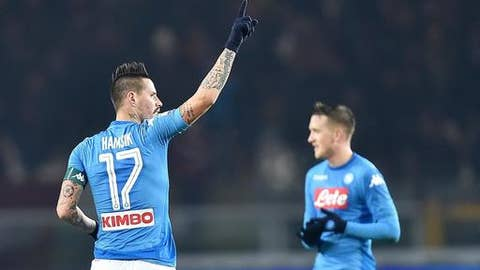 Napoli miedfielder Marek Hamsik celebrates after scoring his side's third goal during the Italian Serie A soccer match between Torino and Napoli at Olympic stadium in Turin, Italy, Saturday, Dec. 16, 2017. (Alessandro Di Marco/ANSA via AP)