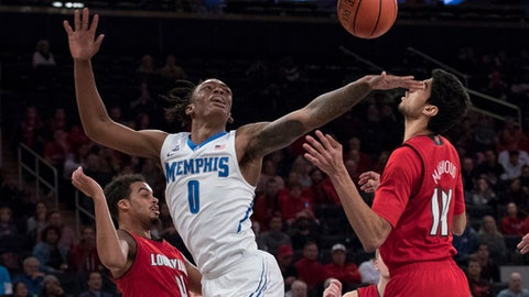 Louisville guard Quentin Snider (4) fouled Memphis forward Kyvon Davenport (0) during the second half of an NCAA college basketball game, Saturday, Dec. 16, 2017, at Madison Square Garden in New York. Louisville won 81-72. (AP Photo/Mary Altaffer)
