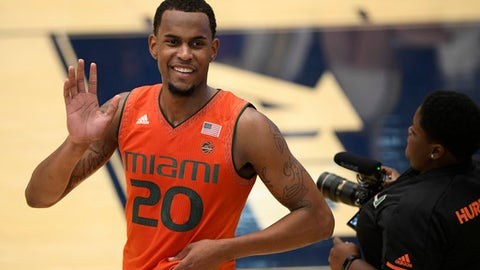 Miami forward Dewan Huell (20) waves to the crowd after an NCAA college basketball game against the George Washington, Saturday, Dec. 16, 2017, in Washington. Miami won 59-50. (AP Photo/Nick Wass)
