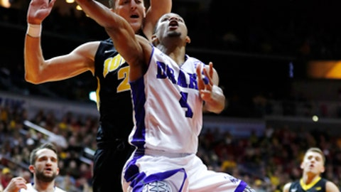 Drake guard De'Antae McMurray (4) drives to the basket ahead of Iowa forward Jack Nunge during the first half of an NCAA college basketball game, Saturday, Dec. 16, 2017, in Des Moines, Iowa. (AP Photo/Charlie Neibergall)