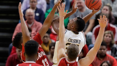 Notre Dame's Bonzie Colson shoots over Indiana's Juwan Morgan (13) and Collin Hartman (30) during the first half of an NCAA college basketball game, Saturday, Dec. 16, 2017, in Indianapolis. (AP Photo/Darron Cummings)