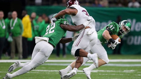 North Texas linebacker Colton McDonald (41) recovers a snap that went over the head of Troy quarterback Brandon Silvers and returns it for a touchdown as North Texas linebacker E.J. Ejiya (22) blocks running back Josh Anderson (33) in the first half of the New Orleans Bowl NCAA college football game in New Orleans, Saturday, Dec. 16, 2017. (AP Photo/Gerald Herbert)