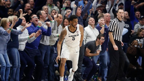 Xavier's Trevon Bluiett (5) reacts after taking the lead with a 2-point shot in the second half of an NCAA college basketball game against East Tennessee State, Saturday, Dec. 16, 2017, in Cincinnati. Xavier won 68-66. (AP Photo/John Minchillo)