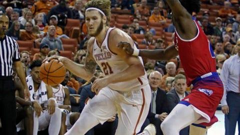 Texas forward Dylan Osetkowski (21) drives to the basket against Louisiana Tech forward Anthony Duruji during the second half of an NCAA college basketball game, Saturday, Dec. 16, 2017, in Austin, Texas. Texas won 75-60. (AP Photo/Michael Thomas)