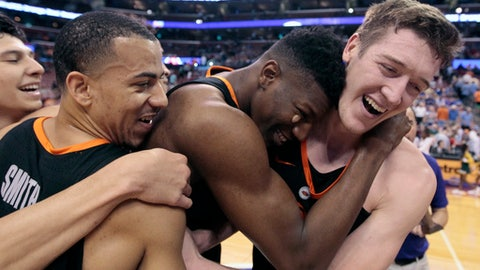 Oklahoma State's Mitchell Solomon, right, celebrates with teammates Kendall Smith, left, and Yankuba Sima, center, after Oklahoma State defeated Florida State 71-70 during an NCAA college basketball game at the Orange Bowl Basketball Classic tournament, Saturday, Dec. 16, 2017, in Sunrise, Fla. Solomon scored the winning basket. (AP Photo/Luis M. Alvarez)