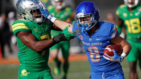 Boise State wide receiver Sean Modster, right, runs by Oregon cornerback Ugochukwu Amadi after making a reception during the first half of the Las Vegas Bowl NCAA college football game Saturday, Dec. 16, 2017, in Las Vegas. (AP Photo/John Locher)