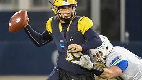 Texas A&M-Commerce Lions quarterback Luis Perez (12) is pressured by West Florida Argonauts defensive lineman John Williamson (30) during the first quarter of their NCAA Division II college football championship game in Kansas City, Kan., Saturday, Dec. 16, 2017. (AP Photo/Reed Hoffmann)