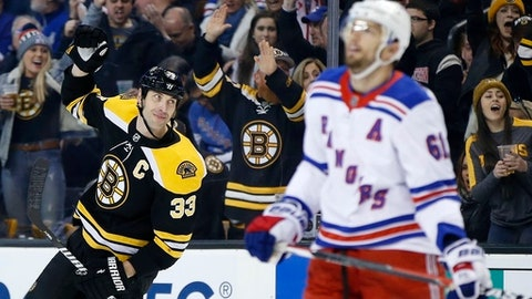 Boston Bruins' Zdeno Chara (33), of Slovakia, celebrates the goal by teammate Danton Heinen behind New York Rangers' Rick Nash (61) during the second period of an NHL hockey game in Boston, Saturday, Dec. 16, 2017. (AP Photo/Michael Dwyer)