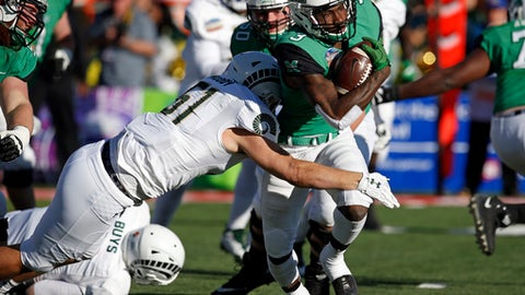 Marshall running back Tyler King (3) is sacked by Colorado State linebacker Patrick Moody (51) during the first half of the New Mexico Bowl NCAA college football game in Albuquerque, N.M., Saturday, Dec. 16, 2017. (AP Photo/Andres Leighton)
