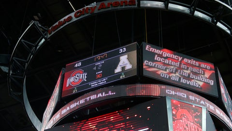 An emergency message is posted on the scoreboard after an emergency situation was declared at Value City Arena during the second half of an NCAA college basketball game between Ohio State and Appalachian State in Columbus, Ohio, Saturday, Dec. 16, 2017. (AP Photo/Paul Vernon)