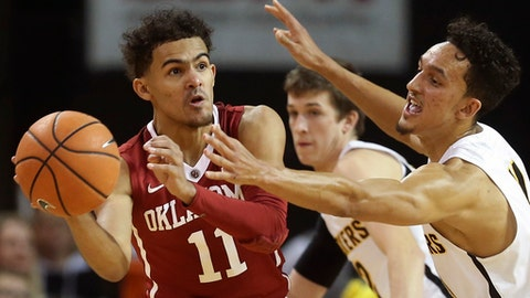 Oklahoma guard Trae Young, left, looks for a pass while Wichita State guard Landry Shamet defends during the second half of an NCAA college basketball game Saturday, Dec. 16, 2017, in Wichita, Kan. (Travis Heying/The Wichita Eagle via AP)