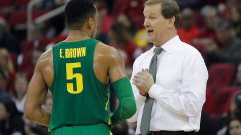 Oregon coach Dana Altman, right, has a discussion with Elijah Brown while playing Fresno State during the second half of an NCAA college basketball game in Fresno, Calif., Saturday, Dec. 16, 2017. (AP Photo/Gary Kazanjian)