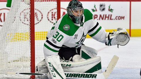 Dallas Stars goalie Ben Bishop looks for a loose puck during the second period of an NHL hockey game against the Philadelphia Flyers, Saturday, Dec. 16, 2017, in Philadelphia. (AP Photo/Derik Hamilton)