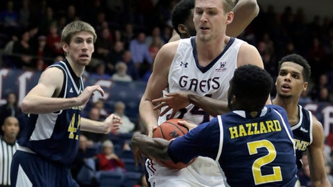 Saint Mary's Jock Landale (34) keeps the ball from UC Irvine's Max Hazzard (2) during the second half of an NCAA college basketball game, Saturday, Dec. 16, 2017, in Moraga, Calif. (AP Photo/Ben Margot)