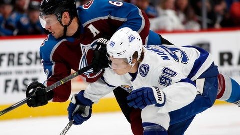 Colorado Avalanche defenseman Erik Johnson, left, checks Tampa Bay Lightning center Vladislav Namestnikov, of Russia, as he drives to the net with the puck in the first period of an NHL hockey game Saturday, Dec. 16, 2017, in Denver. (AP Photo/David Zalubowski)